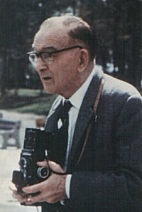 11k jpg - photo of Cyril Fagan holding a camera